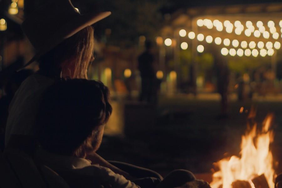 Couple sitting around fire pits
